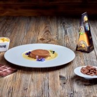 Chocolate panna cotta with Džiugas Gourmet cheese (36-month-ripened) and saffron cream